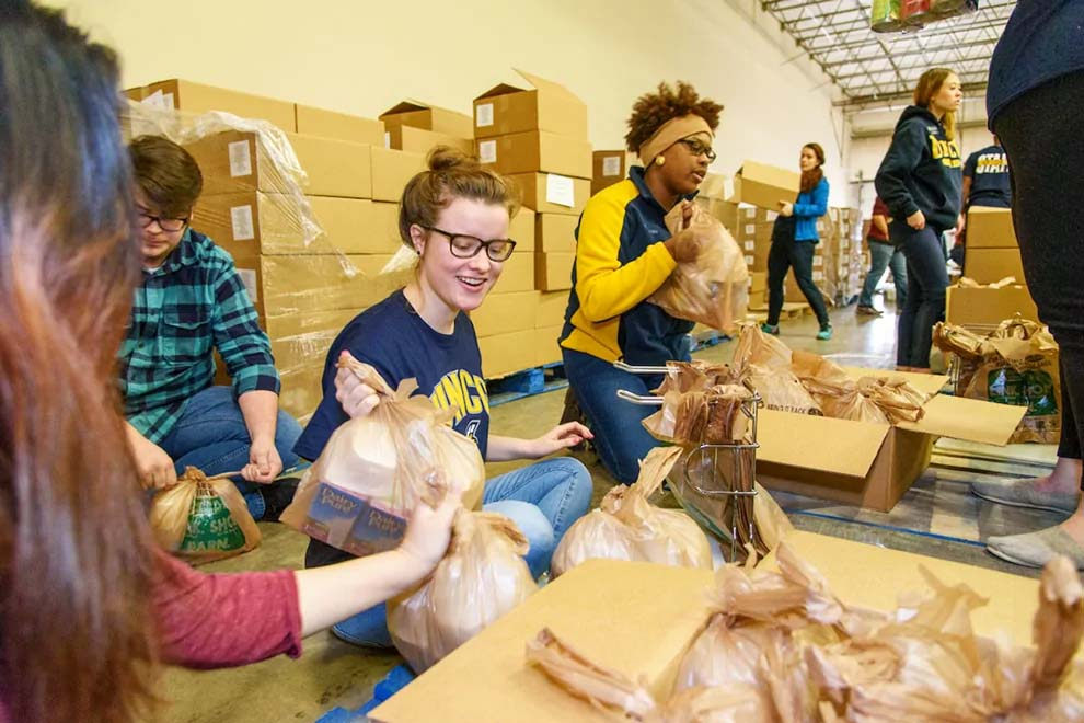 UNC Greensboro students participating in Backpack Beginnings, a community service event
